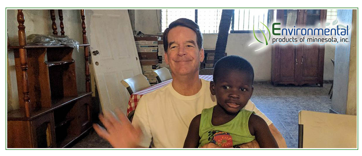 Jim with little boy - Water Treatment Project